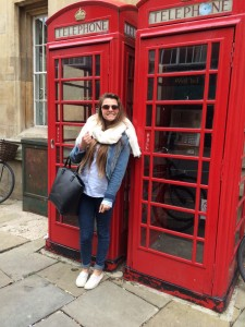 Girl_in_front_of_telephone_boxes